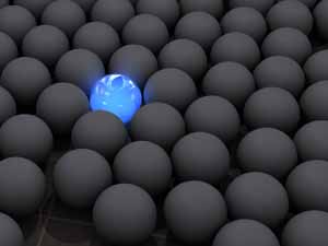 a blue ball in a sea of black balls